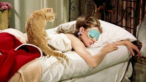 audrey-as-holly-in-sleep-mask_with-cat-on-back